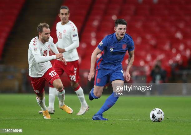 Christian Eriksen of Denmark battles for possession with Declan Rice of England during the UEFA Nations League group stage match between England and...