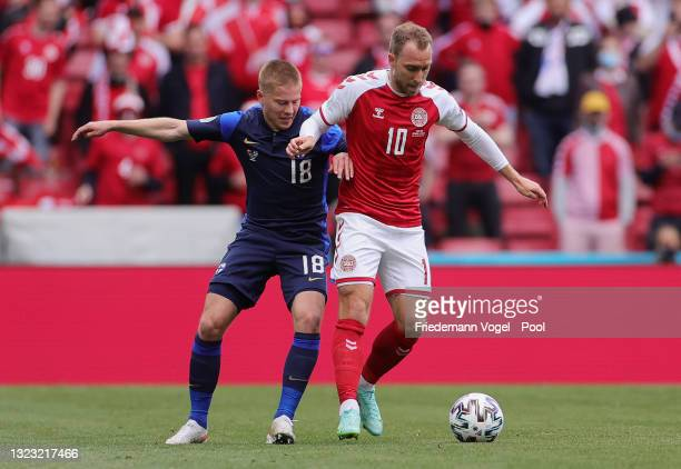 Christian Eriksen of Denmark battles for possession with Jere Uronen of Finland during the UEFA Euro 2020 Championship Group B match between Denmark...