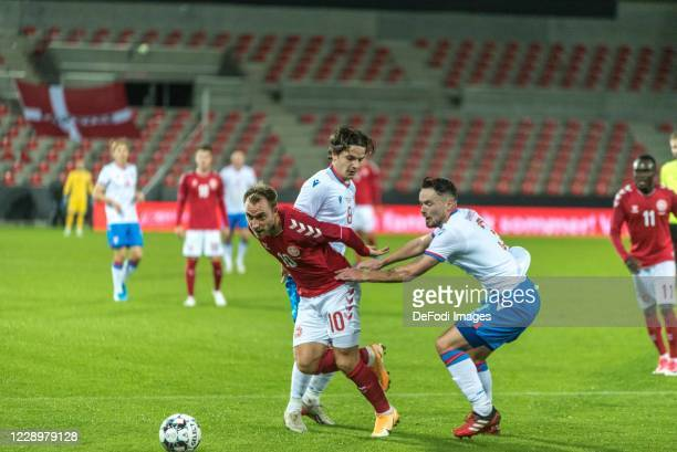 Christian Eriksen of Denmark Brandur Hendriksson of Faroe Islands Battle for the ball during the international friendly match between Denmark and...
