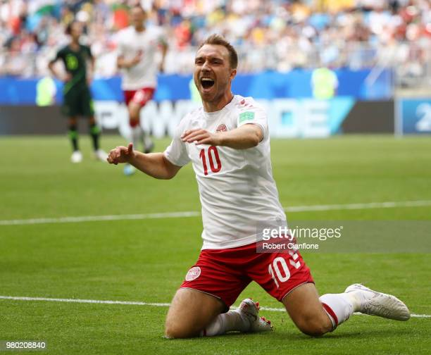 Christian Eriksen of Denmark celebrates after scoring his team's first goal during the 2018 FIFA World Cup Russia group C match between Denmark and...