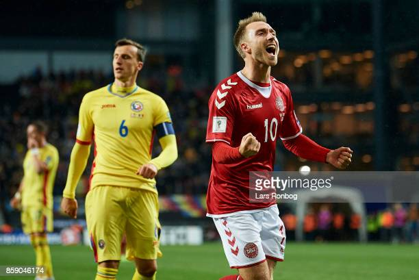 Christian Eriksen of Denmark celebrates after scoring their first goal during the FIFA World Cup 2018 qualifier match between Denmark and Romania at...