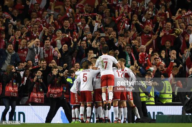 Christian Eriksen of Denmark celebrates scoring his sides fourth goal with his Denmark team mates during the FIFA 2018 World Cup Qualifier PlayOff...