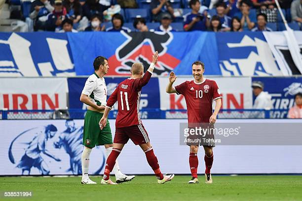 Christian Eriksen of Denmark celebrates scoring his team's third goal with his team mate Viktor Fischer during the international friendly match...