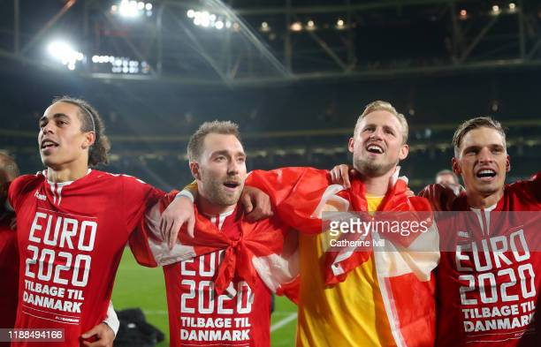 Christian Eriksen of Denmark celebrates with Kasper Schmeichel of Denmark and team mates after the UEFA Euro 2020 qualifier between Republic of...
