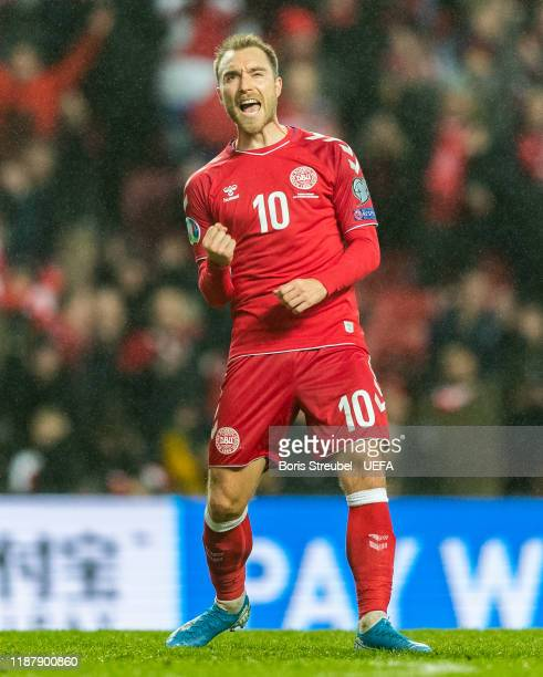 Christian Eriksen of Denmark celebrates with team mates after scoring his team's fifth goal during the UEFA Euro 2020 Qualifier between Denmark and...