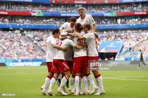 Christian Eriksen of Denmark celebrates with teammates after scoring his team's first goal during the 2018 FIFA World Cup Russia group C match...