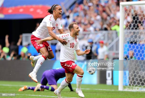Christian Eriksen of Denmark celebrates with Yussuf Yurary Poulsen of Denmark after scoring the opening goal during the 2018 FIFA World Cup Russia...
