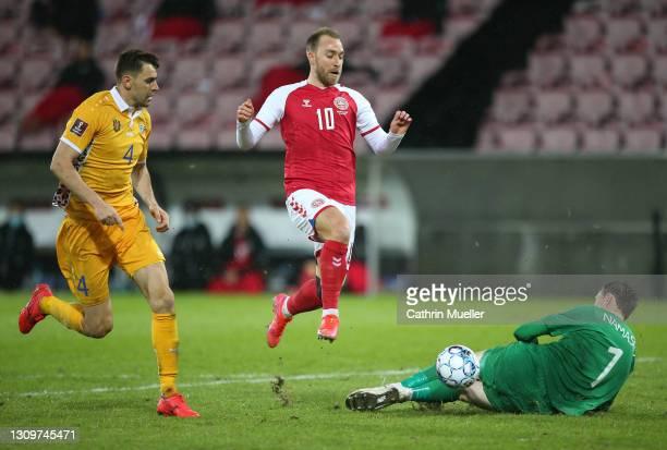 Christian Eriksen of Denmark fails to score against Stanislav Namasco , Goalkeeper of Moldova during the FIFA World Cup 2022 Qatar qualifying match...