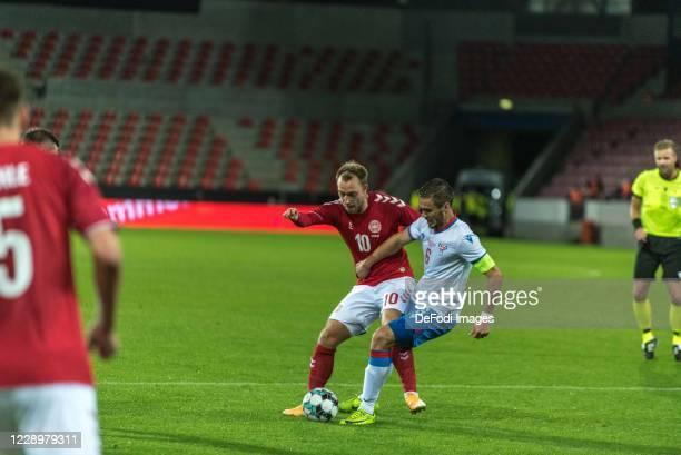 Christian Eriksen of Denmark Hallur Hansson of Faroe Islands Battle for the ball during the international friendly match between Denmark and Faroe...