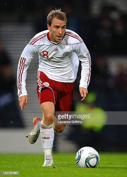 Christian Eriksen of Denmark in action during the International Friendly Match between Scotland and Denmark at Hampden Park on August 10 2011 in...