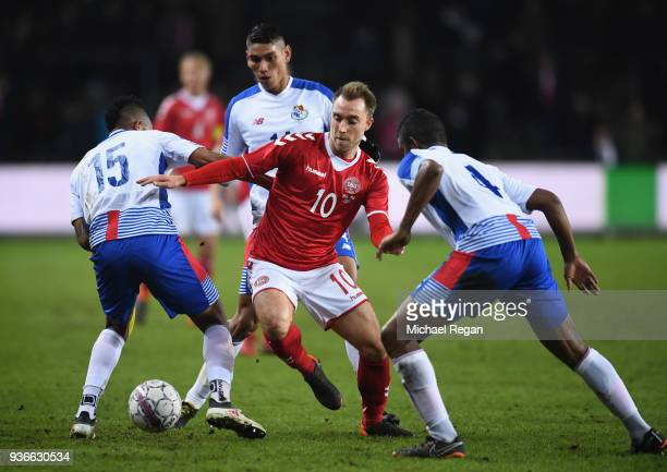 Christian Eriksen of Denmark is challenged by Eric Davis and Fidel Escobar of Panama during the International Friendly match between Denmark and...