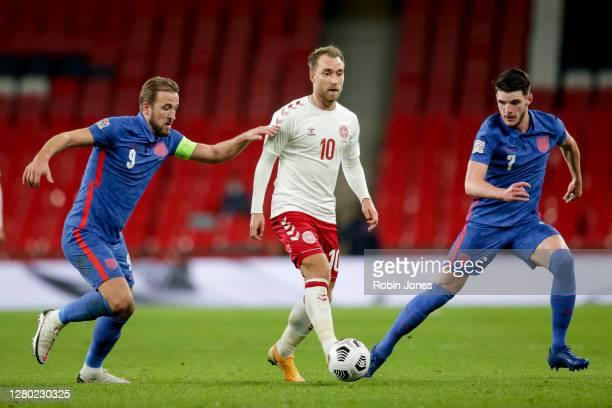 Christian Eriksen of Denmark is closed down by Harry Kane and Declan Rice of England during the UEFA Nations League group stage match between England...