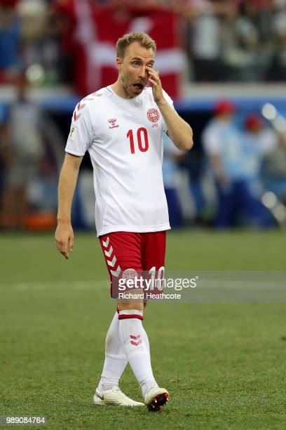 Christian Eriksen of Denmark looks dejected following his sides defeat in the 2018 FIFA World Cup Russia Round of 16 match between Croatia and...
