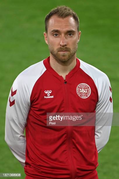 Christian Eriksen of Denmark looks on during the national anthem prior to the international friendly match between Germany and Denmark at Tivoli...