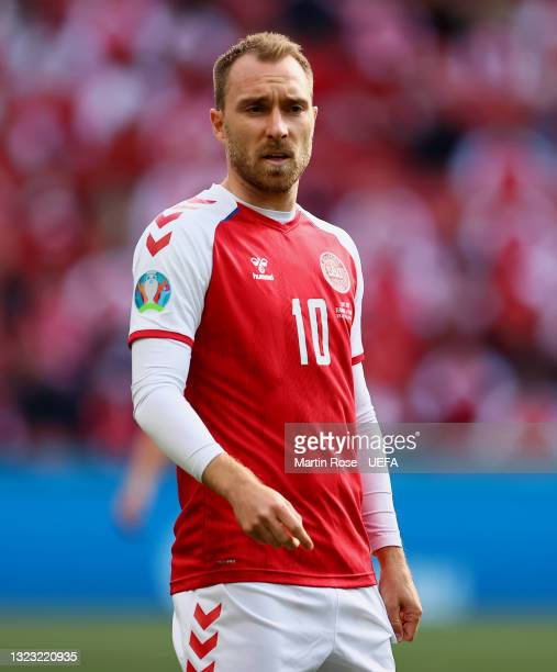 Christian Eriksen of Denmark looks on during the UEFA Euro 2020 Championship Group B match between Denmark and Finland on June 12, 2021 in...
