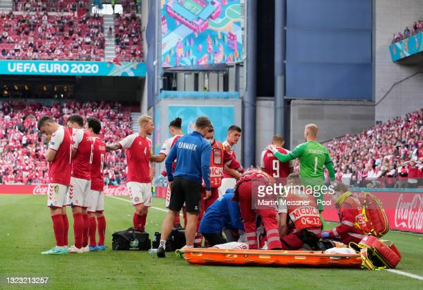Christian Eriksen of Denmark receives medical treatment during the UEFA Euro 2020 Championship Group B match between Denmark and Finland on June 12,...