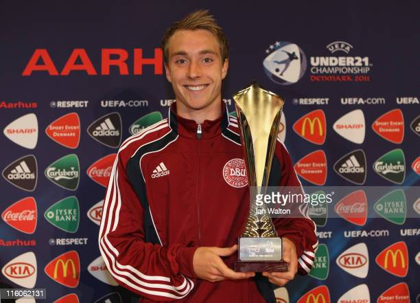 Christian Eriksen of Denmark receives the Man Of The Match trophy after the UEFA European Under21 Championship Group A match between Denmark and...
