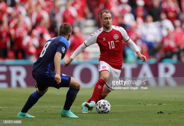 Christian Eriksen of Denmark runs with the ball during the UEFA Euro 2020 Championship Group B match between Denmark and Finland on June 12, 2021 in...