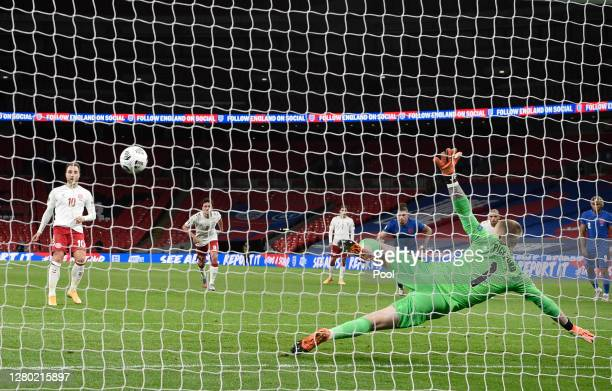 Christian Eriksen of Denmark scores his team's first goal from the penalty spot past Jordan Pickford of England during the UEFA Nations League group...