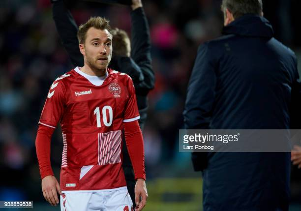 Christian Eriksen of Denmark speaks to Age Hareide of Denmark during the International friendly match between Denmark and Chile at Aalborg Stadion on...
