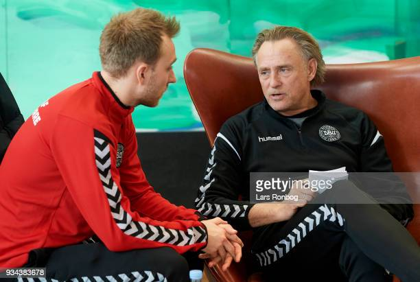 Christian Eriksen of Denmark speaks to goalkeeper coach Lars High during the Denmark press conference at Clarion Hotel Copenhagen Airport on March 19...