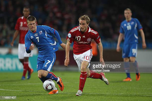 Christian Eriksen of Denmark tracked by Johann Gudmundsson during the UEFA European Under21 Championship Group A match between Iceland and Denmark at...