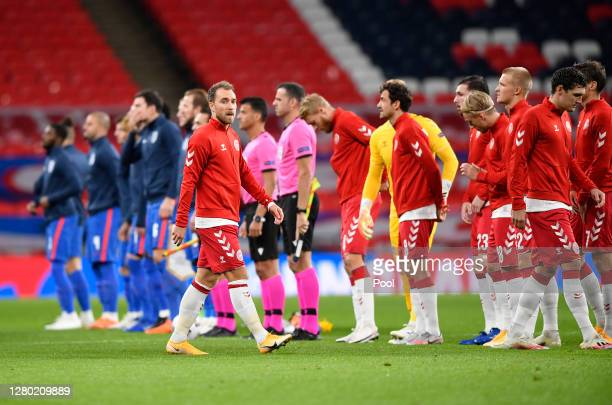 Christian Eriksen of Denmark walks onto the pitch to line up with his team during the UEFA Nations League group stage match between Scotland and...