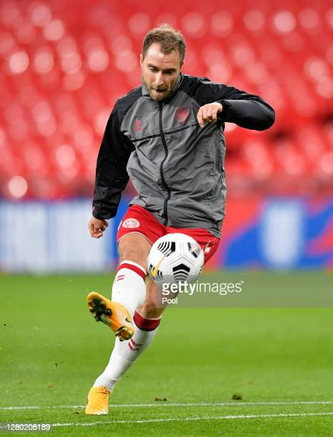 Christian Eriksen of Denmark warms up ahead of the UEFA Nations League group stage match between England and Denmark at Wembley Stadium on October 14...
