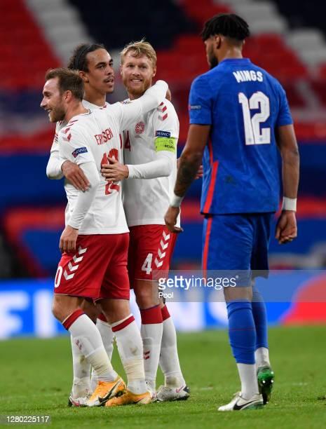 Christian Eriksen of Denmark Yussuf Poulsen of Denmark and Simon Kjaer of Denmark celebrate after the UEFA Nations League group stage match between...