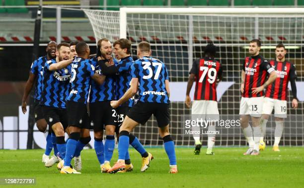 Christian Eriksen of FC Internazionale celebrates with team mates after scoring their team's second goal during the Coppa Italia match between FC...
