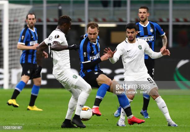 Christian Eriksen of FC Internazionale compete for the ball with Cauly of Ludogorets during the UEFA Europa League round of 32 second leg match...