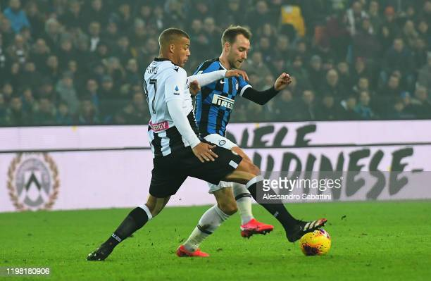 Christian Eriksen of FC Internazionale competes for the ball with Sebastian De Maio of Udinese Calcio during the Serie A match between Udinese Calcio...