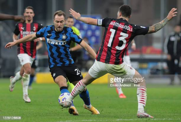 Christian Eriksen of FC Internazionale competes for the ball with Alessio Romagnoli of AC Milan during the Serie A match between FC Internazionale...