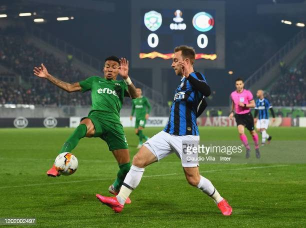 Christian Eriksen of FC Internazionale fights for the ball against Anicet Abel of PFC Ludogorets Razgrad during the UEFA Europa League round of 32...