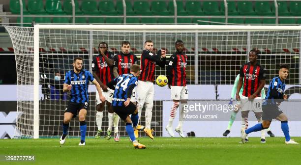 Christian Eriksen of FC Internazionale scores their team's second goal during the Coppa Italia match between FC Internazionale and AC Milan at Stadio...