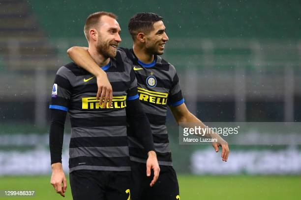 Christian Eriksen of Internazionale celebrates with team mate Achraf Hakimi after their first goal was an own goal scored by Riccardo Improta of...