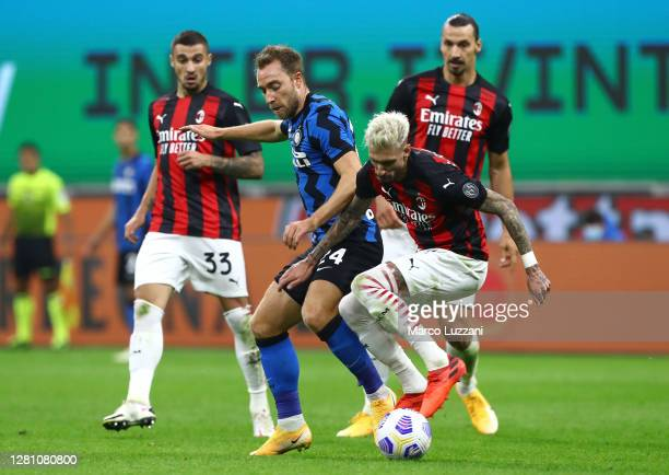 Christian Eriksen of Internazionale competes for the ball with Samuel Castillejo of AC Milan during the Serie A match between FC Internazionale and...