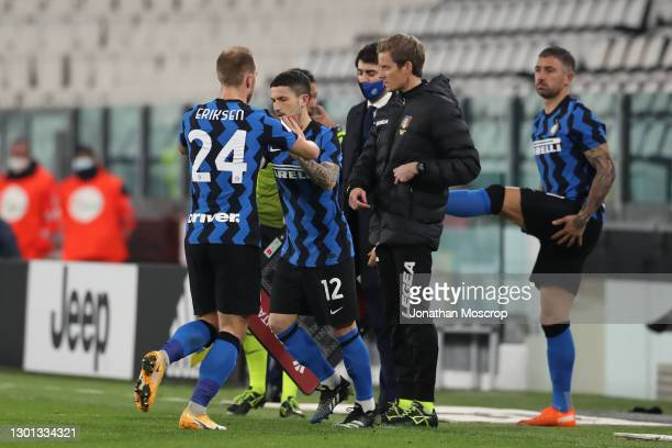 Christian Eriksen of Internazionale is substituted for Stefano Sensi during the Coppa Italia semi-final between Juventus and FC Internazionale at...