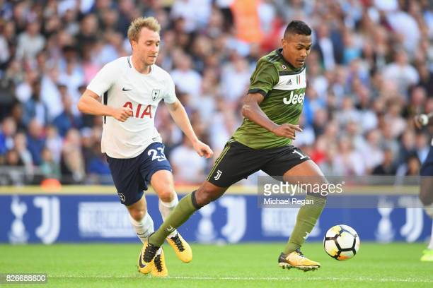 Christian Eriksen of Spurs and Alex Sandro Lobo Silva of Juventus in action during the preseason match between Tottenham Hotspur and Juventus at...