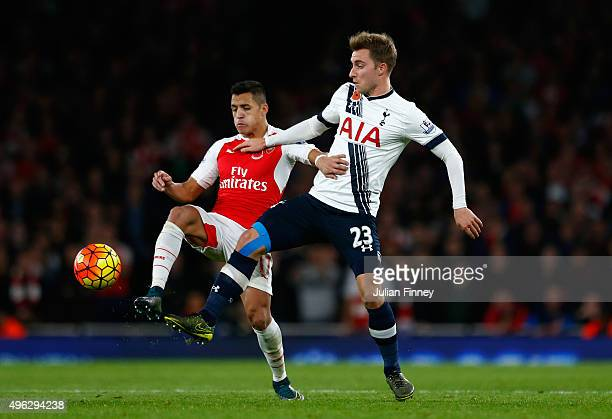 Christian Eriksen of Spurs battles for the ball with Alexis Sanchez of Arsenal during the Barclays Premier League match between Arsenal and Tottenham...