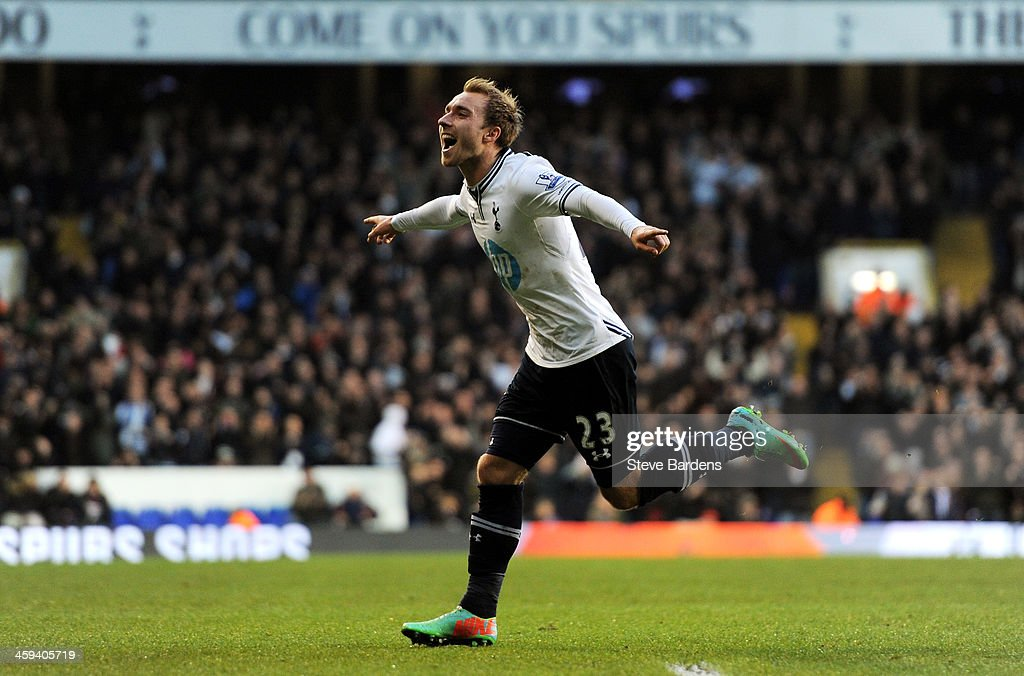 Christian Eriksen of Spurs celebrates after scoring the opening goal from a free kick during the Barclays Premier League match between Tottenham Hotspur and West Bromwich Albion on December 26 2013 in London, England.