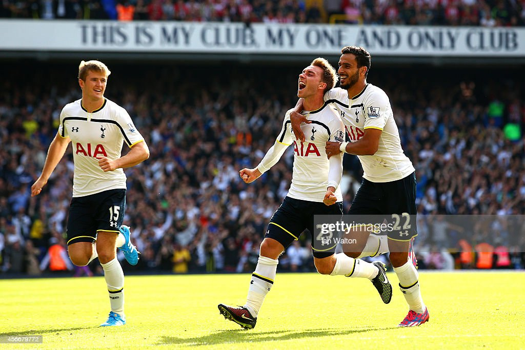 Christian Eriksen of Spurs celebrates with team-mates Nacer Chadli and Eric Dier after scoring the opening goal during the Barclays Premier League match between Tottenham Hotspur and Southampton at White Hart Lane on October 5, 2014 in London, England.