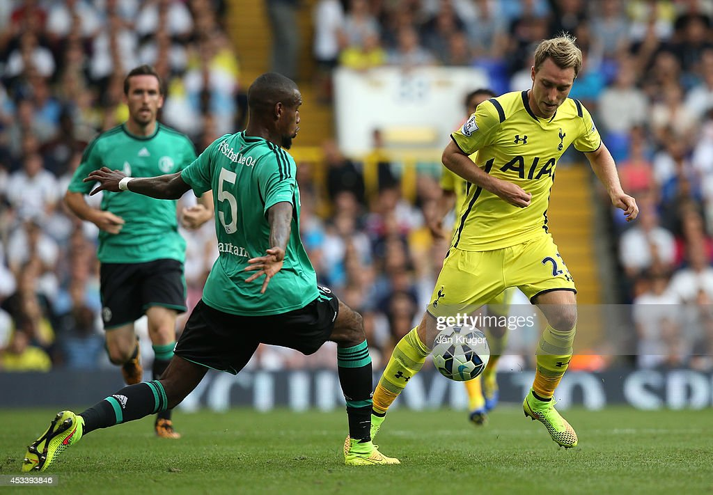 Christian Eriksen of Spurs controls the ball from Felipe Santana of Schalke during a pre season friendly match between Tottenham Hotspur and FC Schalke at White Hart Lane on August 9, 2014 in London, England.