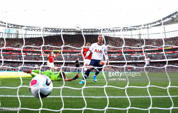 Christian Eriksen of Spurs follows up to score the first goal during the Premier League match between Arsenal FC and Tottenham Hotspur at Emirates...