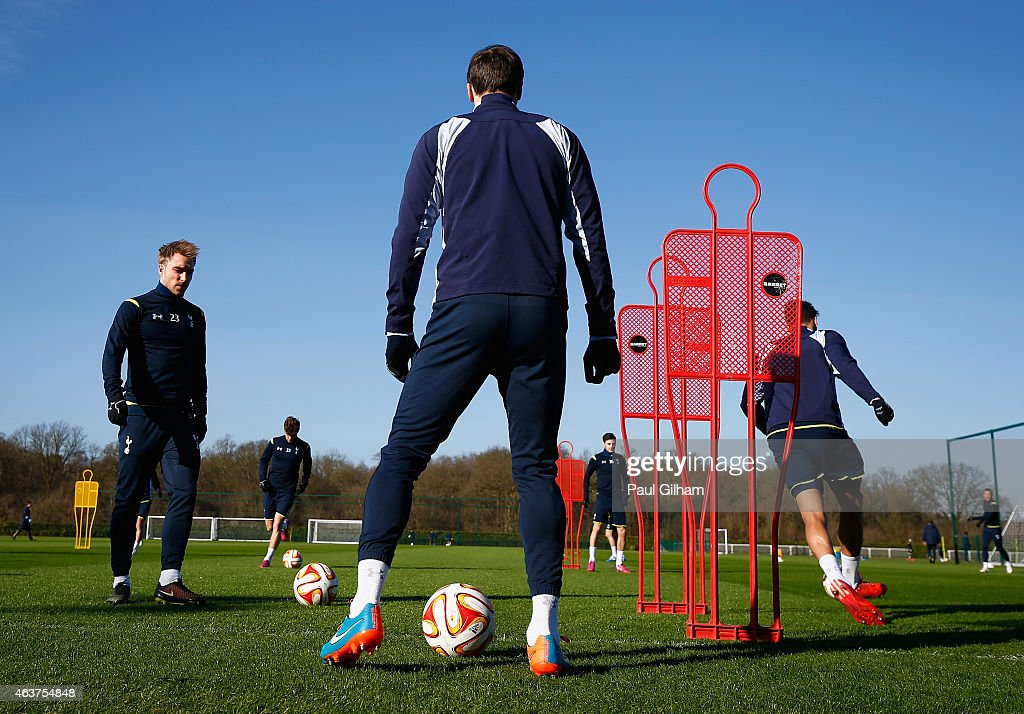 Christian Eriksen of Spurs (L) in action during a training session ahead of the UEFA Europa League round of 32 first leg match against Fiorentina at Enfield Training Centre on February 18, 2015 in Enfield, United Kingdom.
