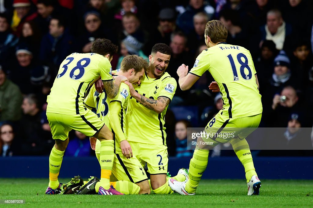 Christian Eriksen (2nd L)of Spurs is congratulated by teammates after scoring the opening goal during the Barclays Premier League match between West Bromwich Albion and Tottenham Hotspur at The Hawthorns on January 31, 2015 in West Bromwich, England.