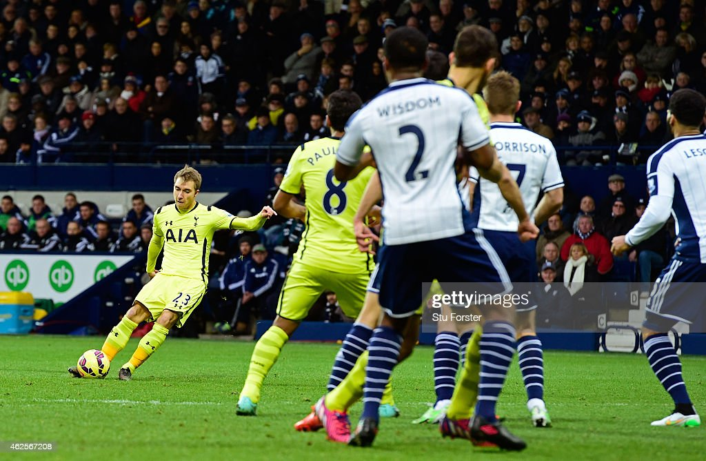 Christian Eriksen (L)of Spurs score the opening goal with a free kick during the Barclays Premier League match between West Bromwich Albion and Tottenham Hotspur at The Hawthorns on January 31, 2015 in West Bromwich, England.