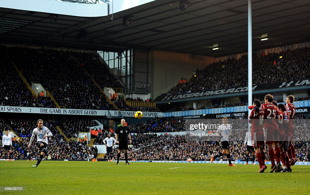 Christian Eriksen of Spurs scores the opening goal from a free kick during the Barclays Premier League match between Tottenham Hotspur and West Bromwich Albion on December 26 2013 in London, England.
