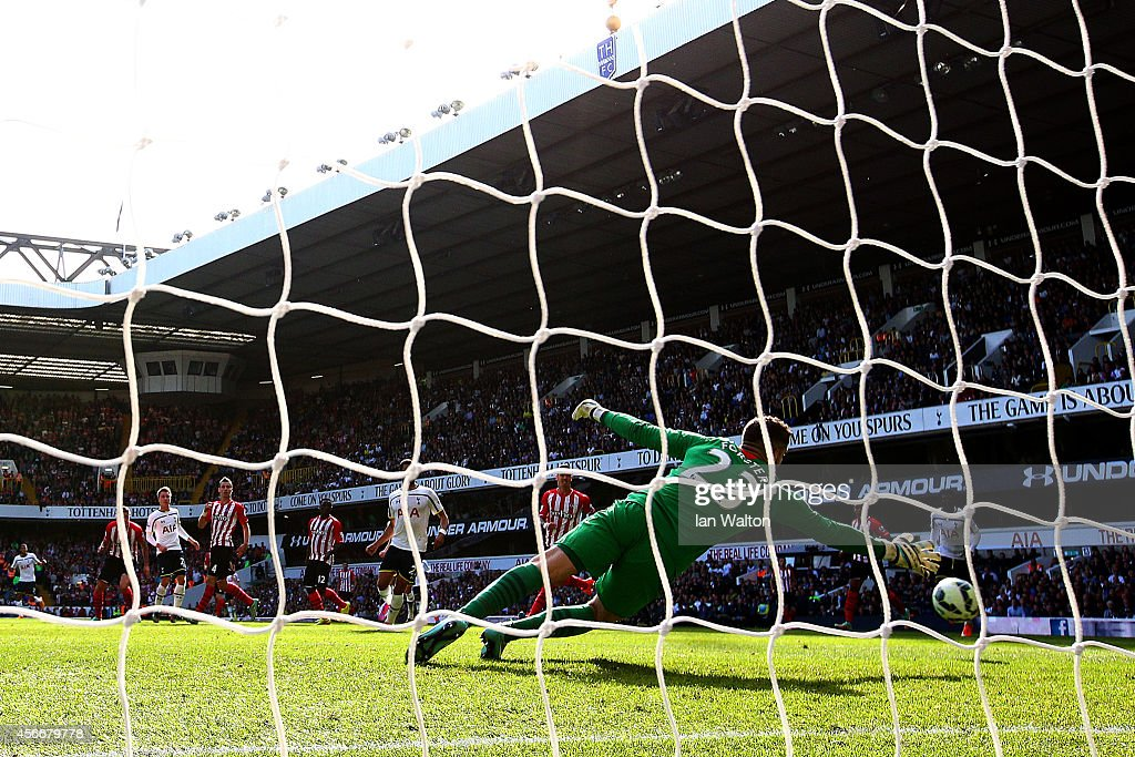 Christian Eriksen of Spurs scores the opening goal past Fraser Forster of Southampton during the Barclays Premier League match between Tottenham Hotspur and Southampton at White Hart Lane on October 5, 2014 in London, England.