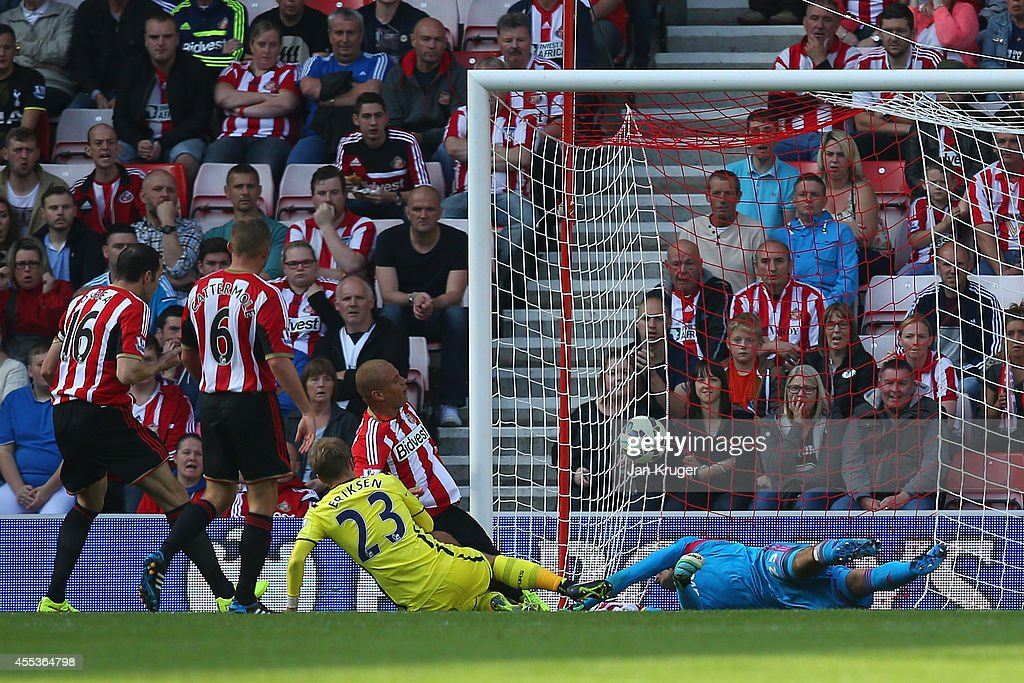 Christian Eriksen of Spurs scores their second goal past Vito Mannone of Sunderland during the Barclays Premier League match between Sunderland and Tottenham Hotspur at Stadium of Light on September 13, 2014 in Sunderland, England.